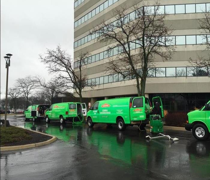 green van outside of commercial loss