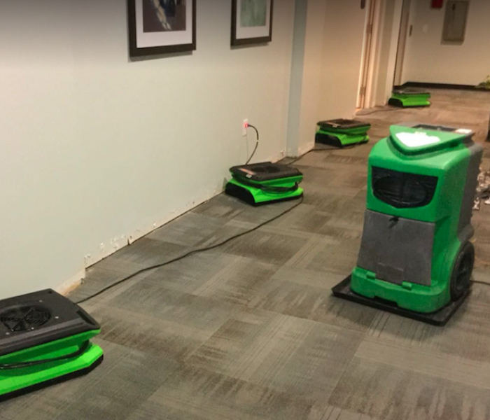equipment set on carpet hallway of commercial facility